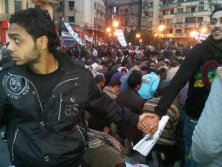 Egyptian Copts protecting Muslims on February 3 on Tahir Square - Public Domain