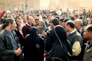 Heba interviews the mother of a missing child in Tahrir Square, Cairo