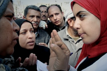Film Still from Words of Witness, showing Heba listening to testimonials on Tahrir Square, Cairo