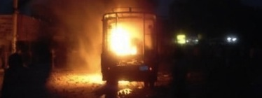 Burning Sudanese police car, shared by @his_moezness