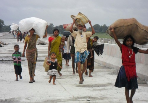Villagers flee their homes in the Chirang district, Assam. Image by Aman. Copyright Demotix (24/7/2012)
