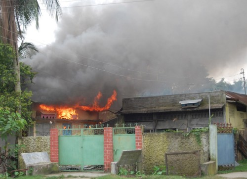 Homes burn in the Barmanpara village in the Kokrajhar district, about 230 kms from Guwahati, the capital of the state of Assam. Image by Aman. Copyright Demotix (24/7/2012)