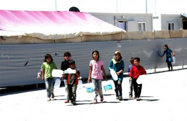 Syrian refugee children getting water at the Kilis camp