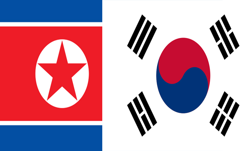 Flags of the two Koreas, the left side is the North Korean flag and the right side is the South Korean flag. Wikipedia Commons Images.