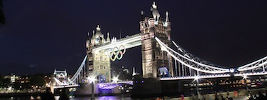 Olympic rings on Tower Bridge, London, at night time. Image by The Department for Culture, Media and Sport on Flickr (CC BY-NC-SA 2.0).