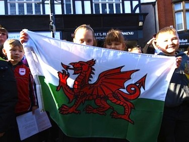 Children from a Welsh school with the Welsh flag. Image by Geoff Abbott, copyright Demotix (01/03/12).