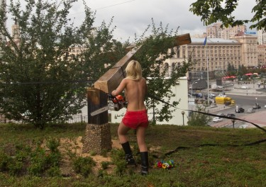 Femen activists saw down cross in solidarity with Pussy Riot. In Kyiv, Ukraine, 17 August 2012, photo by ukrafoto ukrainian news, copyright © Demotix.