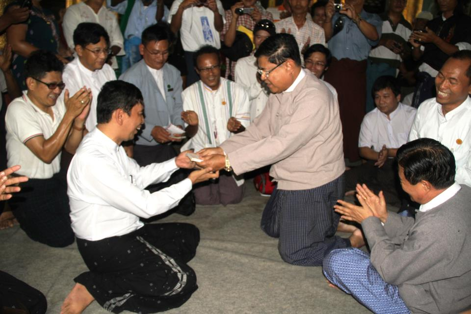 88 Generation Student Leader, Min Ko Naing accepting a donation from a government minister on 7 August, 2012. Image by 88 Generation Students Facebook page.