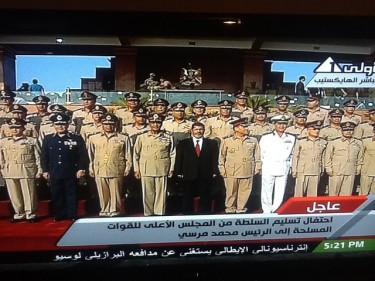 A TV screenshot featuring Mohamed Morsi surrounded by the Egyptian Army's top chiefs in the day of his inauguration as president. Photo from Flickr by Zeinab Mohamed (CC BY-NC-SA 2.0)