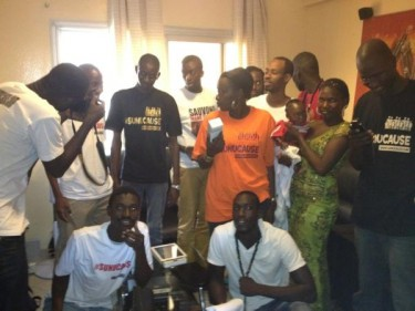 Sunucause team taking pictures with the family of Mame Thierno by @BoompasticPio on Twitter (used with permission).