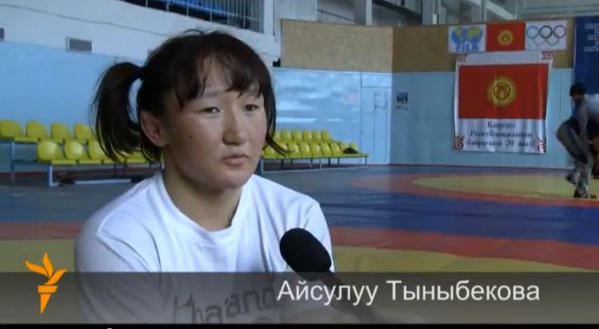 "Aisuluu Tynybekova, Kyrgyzstan's first woman to compete in freestyle wrestling at the Olympics. Screenshot from video ""Aisuluu"" uploaded on YouTube on May 11, 2012, by Radio Azzatyk."