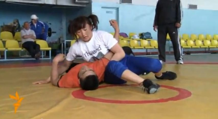 "Tynybekova's training consists of sparring with heavier male athletes. Screenshot from video ""Aisuluu"" uploaded on YouTube on May 11, 2012, by Radio Azzatyk."