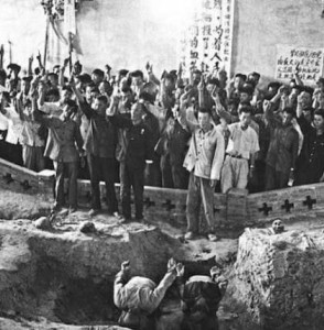 "A historical photo showing the public execution of people from the ""Black Five Categories"" during the Cultural Revolution. Public domain photo via Molihua."
