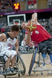 Adam Lancia is blocked by Shingo Gujii during the preliminary group B wheelchair basketball match between Canada and Japan. Image by Clive Chilvers, copyright Demotix (30/08/12).