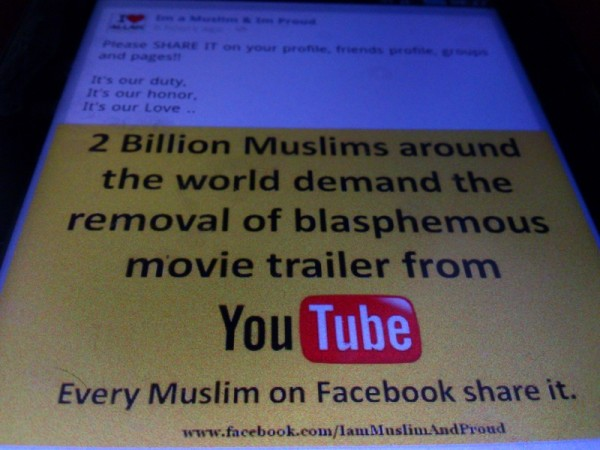 Facebook status of the largest Islamic faith community online on its demand to remove blasphemous movie about Mohammed at YouTube. Image by Sherbien Dacalanio. copyright Demotix
