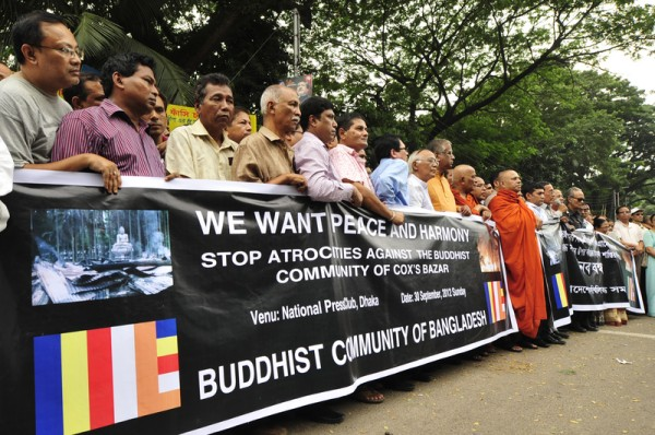 People from the Buddhist community take part at the protest rally in front of the National Press Club in the capital Dhaka. Image by Firoz Ahmed. Copyright Demotix (30/9/2012)