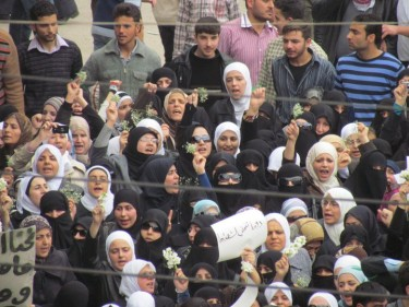 Syrian women protesting in Douma in April, 2011. Photograph from Syriana2011 photostream on flickr, used under  (CC BY 2.0)