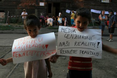 "Přednádraží children holding posters that read: ""The media are censoring our reality! Tell the truth!"" Photo by Daniela Kantorova."
