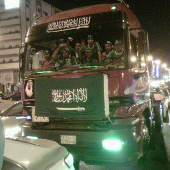 A bus full of young Saudi men celebrating National Day