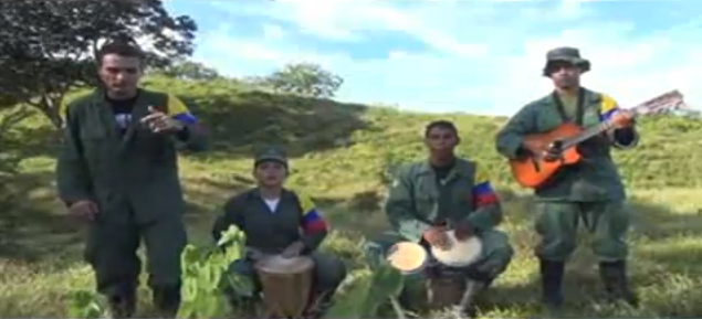 Colombian guerrillas sing rap inspired by forthcoming peace negotiations. Screencapture from video.
