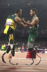 Oscar Pistorius congratulates Brazil's Alan Oliveira after he won the Paralympic T44 200 metres at the London Paralympic games. The favourite Oscar Pistorius came in only second after the world record in the qualification heat. Image by Mauro Ujetto, copyright Demotix (02/09/12).