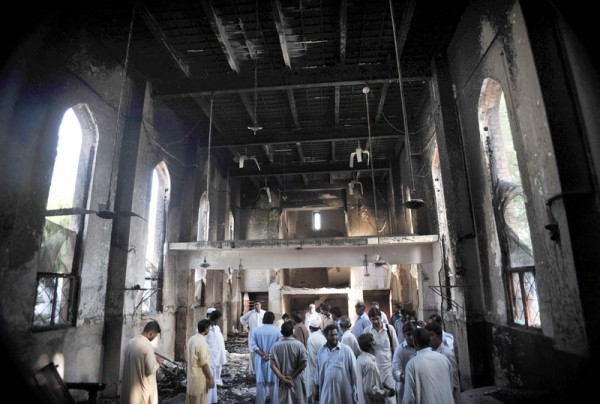 People gather at burnt Sarhadi Lutheran Church which was set ablaze by angry protesters during demonstrations against blasphemy anti-Islamic movie. Image by Owais Aslam Ali. Copyright Demotix (22/9/2012)