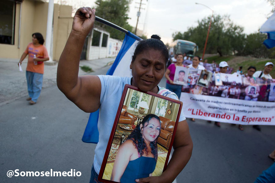 Suyapa Socorro walks through the streets of Reynosa, Mexico, holding an image of her missing daughter. Photo by Mario Marlo
