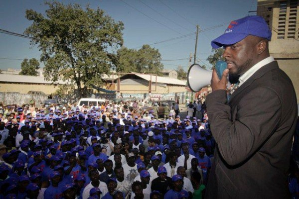 Wyclef Speaking to Crowd In Haiti