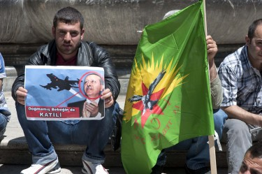 Kurds hold banners and flags against the President of Turkey in Rome, Italy. Image by Stefano Montesi, copyright Demotix (08/05/12).