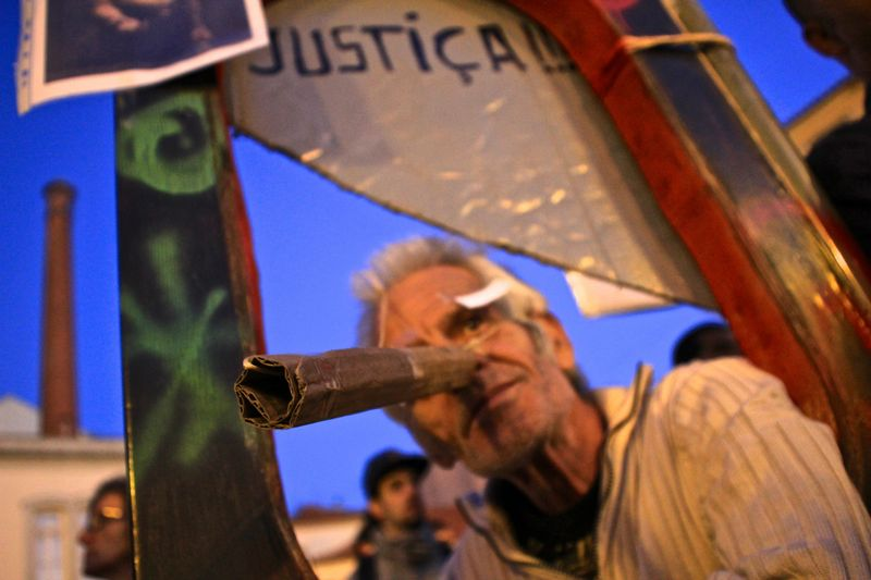 """A man wears a mock 'Pinocchio' nose as thousands gathered outside the Portuguese parliament to demonstrate against renewed austerity measures introduced by the Portuguese government."" Photo by Violeta Moura copyright Demotix (15/10/2012)"