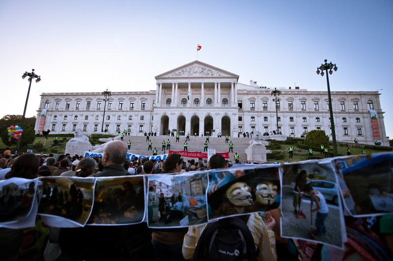 """Several thousand people gather in front of the Portuguese parliament to demand the resignation of the government following the announcement of a new budget."" Photo by Xavier Malafosse copyright Demotix (15/10/2012)"