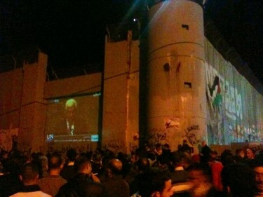 Abbas' UN speech screened on a separation wall with Israel in Bethlehem