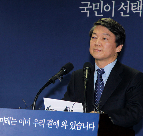 Ahn speaking at a press conference