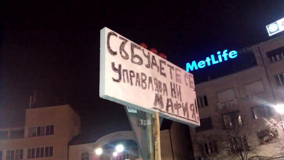 """Wake up, the mafia rules us!"" A banner from the demo. Image by Ruslan Trad (CC-by-SA 3.0)"