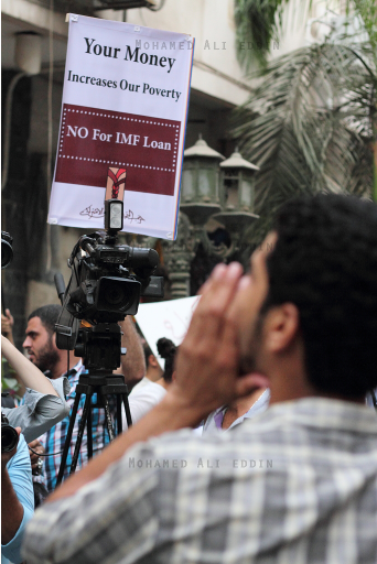 'Your money increases our poverty' banner raised by protesters against IMF loan during IMF delegation visit to Cairo. Photo by Mohamed Ali Eddin