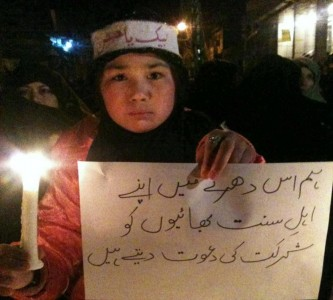 "A young Shia girl asking her ""Sunni Brothers"" to join the protest."