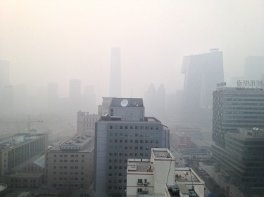 The pollution engulfed the city with heavy haze and reduced visibility.
