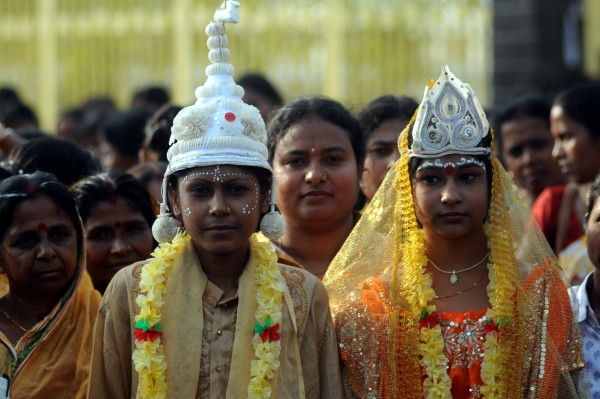 Girls dressed as young bride and groom for an awareness campaign against child bride. Agartala, India. Image by Reporter#24728. /Copyright Demotix (7/3/2012)