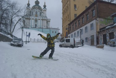 One of the main routes for snowboarders on this day was Andriyivsky Descent, one of Kyiv's historical streets. On the photo - a snowboarder and the St. Andrew's Church in the background. Photo by Stas Kozlyuk, copyright © Demotix (23/03/13).