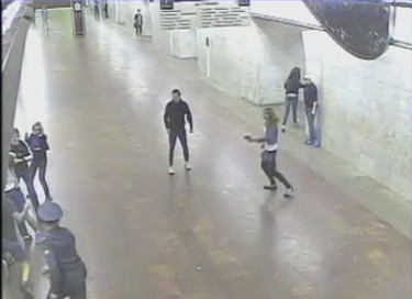 Grainy security footage of Lotkova firing off a shot. Screenshot, MK.