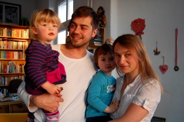 The whole family in their flat in Berlin. Photo by Kasia Odrozek
