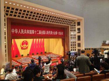 Wen read a carefully scripted government work report to a sea of reporters and legislators at the 2013 China's National People's Congress.