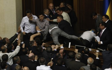 A violent scuffle erupted in Ukraine's parliament over a bill that would allow the use of the Russian language in courts, hospitals and other institutions in the Russian-speaking regions of the country. Photo by Sergei Svetlitsky, copyright © Demotix (24/05/12).