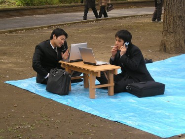 Japanese businessmen working in the park Photo by GaijinSeb (CC BY-NC-ND 2.0)