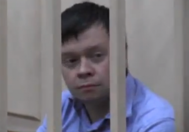 Konstantin Lebedev in pretrial detention, 18 October 2012, screen capture from YouTube.