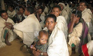 Displaced Amharas waiting for food and shelter. Photo courtesy of Ethiopian Satellite Television.