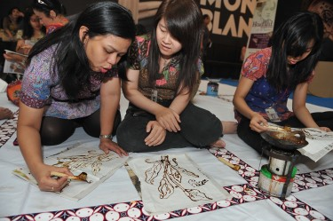 Women making batik pieces together in celebration of Kartini Day. Photo by Robertus Pudyanto, copyright @Demotix 4/20/2012