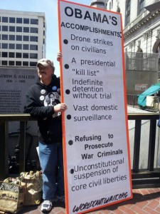 A protestor in the anti-drones protest in San Farancisco holding a sign opposing drones and extrajudicial killings