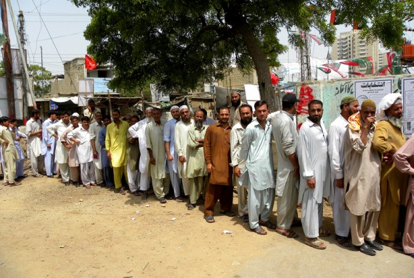 People stand in a queue to cast their vote at a polling station during the phase of the election in Karachi, Pakistan on Saturday 11 may 2013.  Hundreds of thousands of Pakistanis went to the polling stations. Image by Rana Zahid 84. Copyright Demotix (11/5/2013)