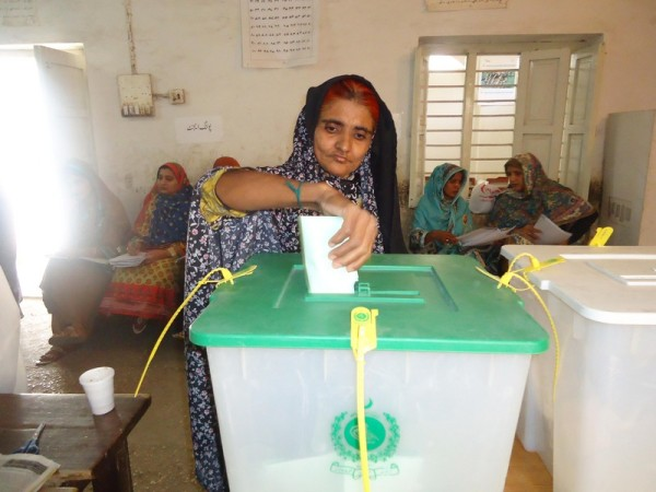 A woman is exercising her right to vote here during general elections 2013 at a polling station in the home town of Benazir Bhutto on Saturday. Image by jamal Dawood. Copyright Demotix (11/5/2013)